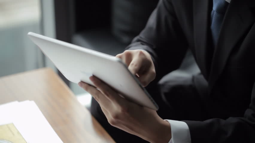 TU CU Businessman using digital tablet in front of window / Beijing, China   Shutterstock HD Video #22502785