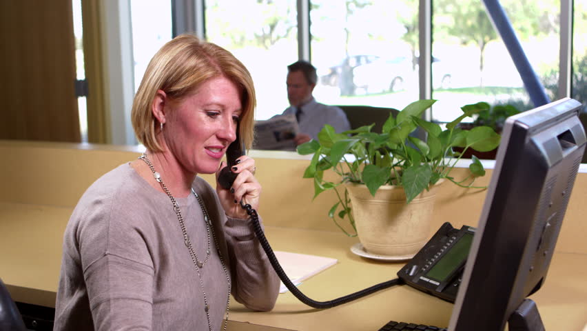 Receptionist works on the computer stock footage video 22528825 receptionist takes a phone call 4k stock footage clip sciox Images