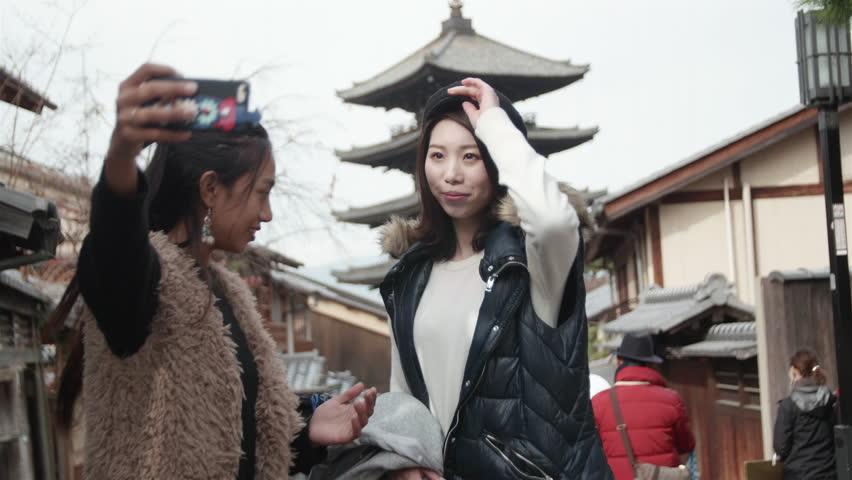 Young International friends take selfie in front of famous temple landmark in Kyoto    Shutterstock HD Video #22541497