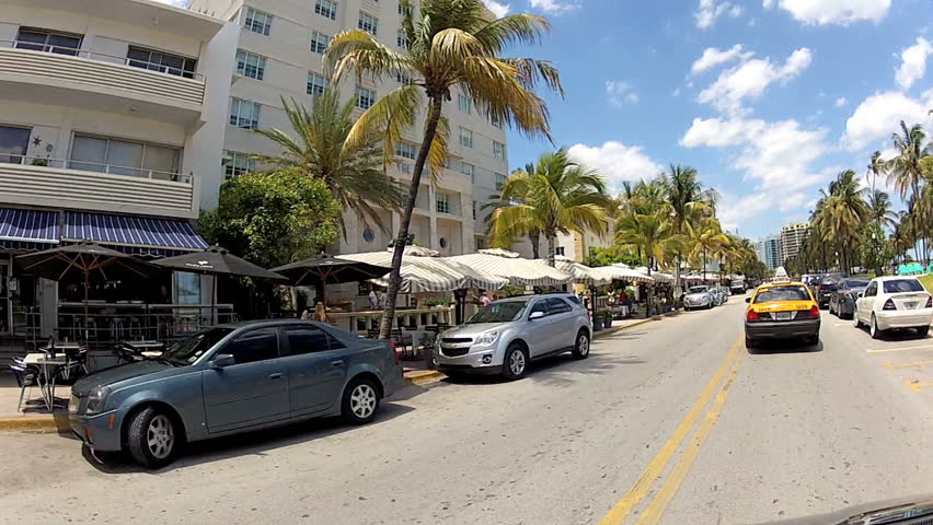 MIAMI, FL - APRIL 28: Drivers point of view of hotels on Ocean Drive, April 28, 2012 in Miami, FL.