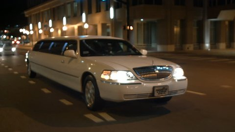 limo drives through urban city night limousine