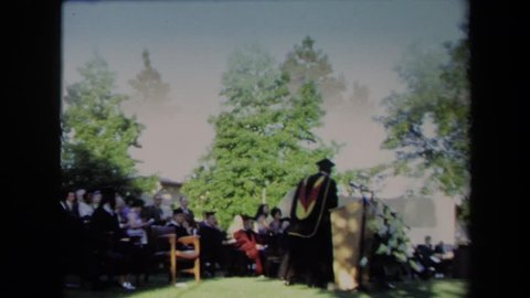 SACRAMENTO CALIFORNIA 1971: alumni comes to the podium to speak after another speaker.