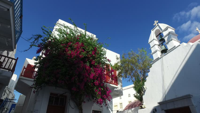 Mykonos houses and flowers of Chora Mykonos is a Greek island, part of the Cyclades 4K (4096x2160)  MOV Compressor:Photo - JPEG