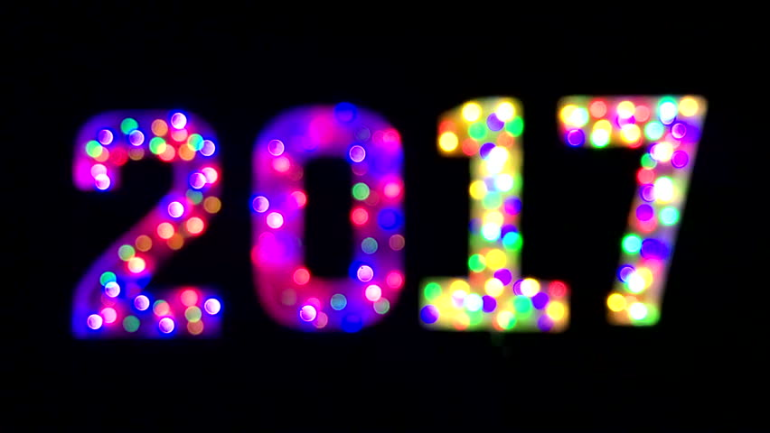 Abstract defocus 2017 New Year message in colorful bokeh light bubbles against black background | Shutterstock HD Video #22624297