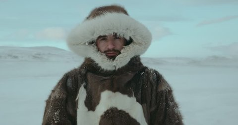 Portrait of young man dressed in reindeer coat. Man looking seriously in camera. Shot on Red Epic