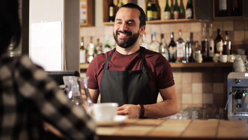 Small business, people and service concept - happy man or waiter with cup serving customer and taking money payment at coffee shop | Shutterstock HD Video #22628827