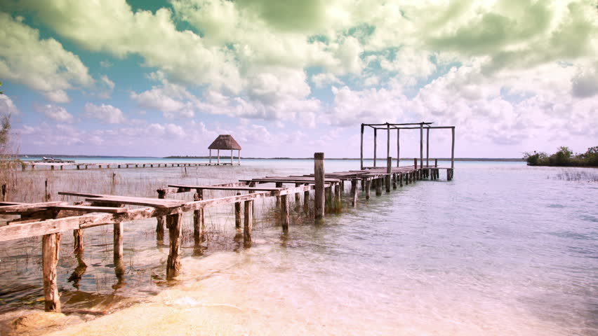 timelapse shot of the beautiful lake bacalar with crystal clear blue water quintana roo beachside hammocks sway in tropical breeze stock footage video      rh   shutterstock