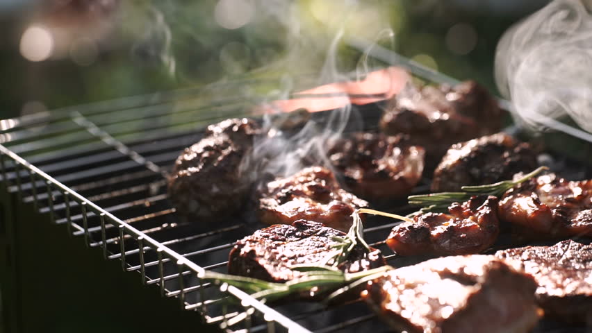 Grill, Frying Fresh Meat, Chicken Barbecue, Sausage, Kebab, Hamburger, vegetables, BBQ, Barbecue, seafood. grilled peppers and onion. Closeup sunny outdoor Chef turns the meat on the grill