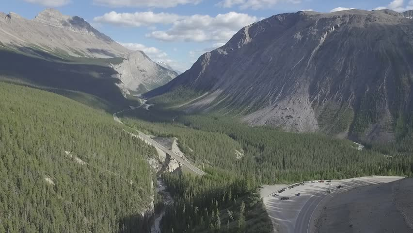 Icefields Parkway Jasper Banff National Park over cliff sunny day 2 aerial