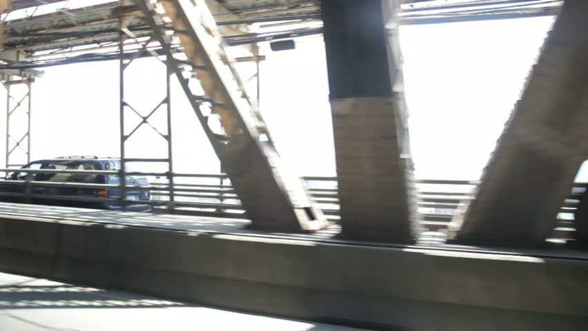 Brooklyn Bridge truss work seen from a moving vehicle