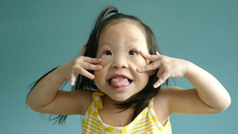Small Asian girl making a funny face ,slow motion