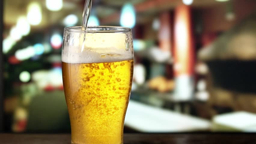 Beer is pouring from the top into the glass. Slow motion 120 fps. | Shutterstock HD Video #22811767