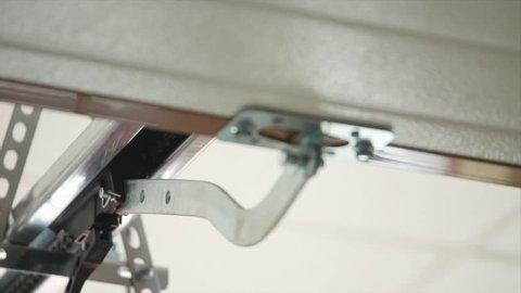 Close up on mechanical garage door opener mechanism.