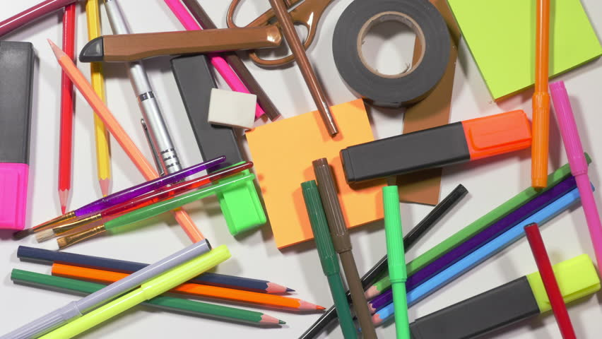 Colorful pencils, markers, scissors, stickers, pen, rulers one by one disappear from pile on table, office supplies, stationery. Close up, stop motion, 4K Ultra HD.