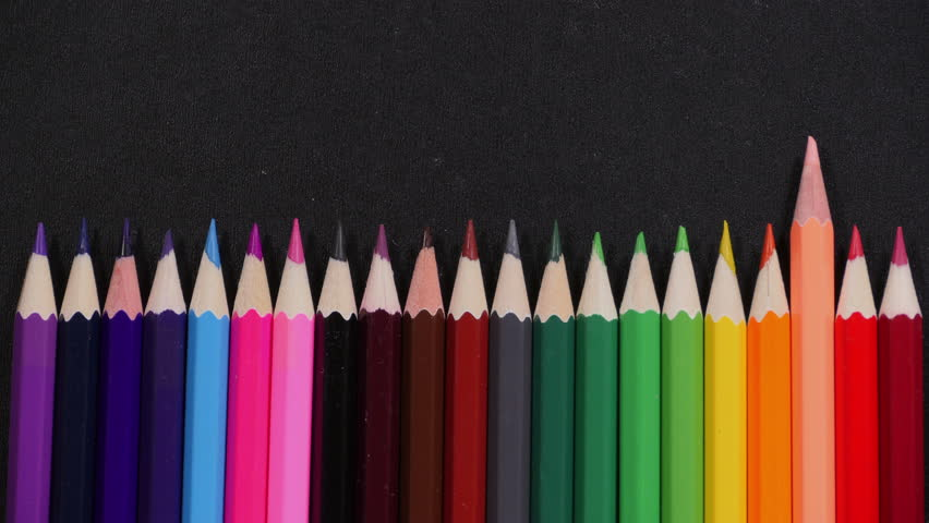 Set of colorful pencils moves out on black ground, each color sticks out in turns, equipment for drawing, stand out of rest. Close up, stop motion, 4K Ultra HD. | Shutterstock HD Video #22882597
