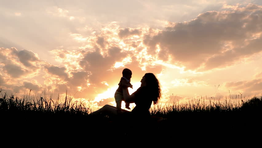 Silhouettes mother and baby sunset | Shutterstock HD Video #2292056