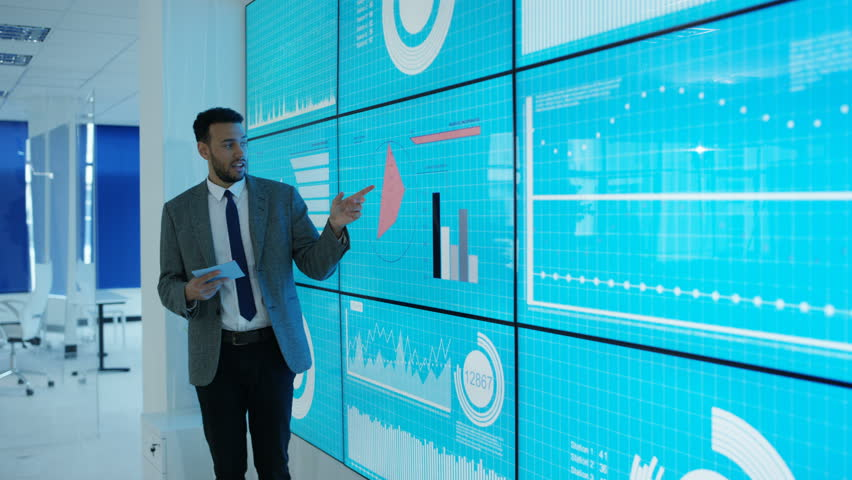 4K Businessman giving a presentation at a business conference Dec 2016-UK