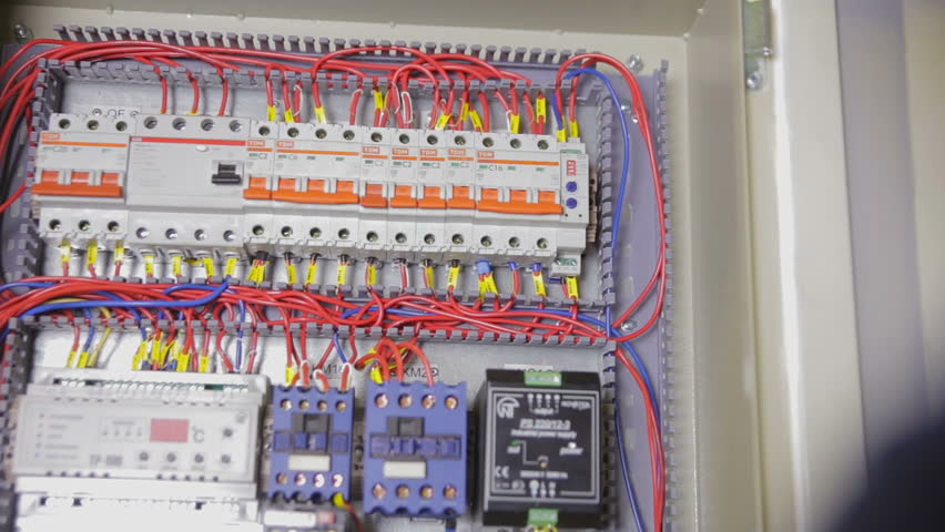 1 electrician hands checking circuit breakers in electrical fuse box how to check fuse on breaker box at aneh.co