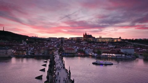aerial view of sunset over Charles Bridge and Prague Castle, Czech Republic