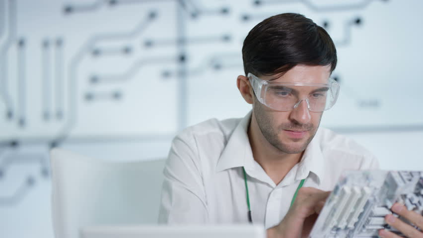 4K Electronics engineer working in lab building & testing electronic devices Dec 2016-UK | Shutterstock HD Video #22964887