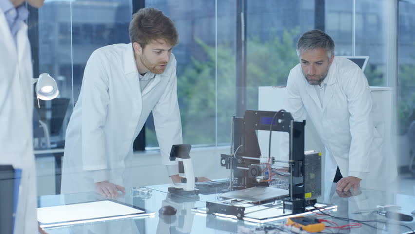 4K Electronic engineering team working in the lab with 3D printer Dec 2016-UK | Shutterstock HD Video #22965937