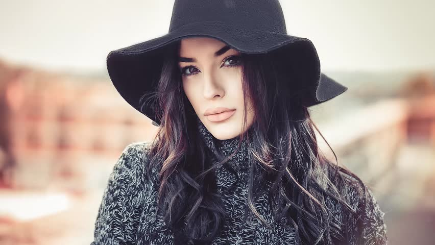 Cinemagraph seamless loop. Winter portrait of fashionable young woman looking at camera