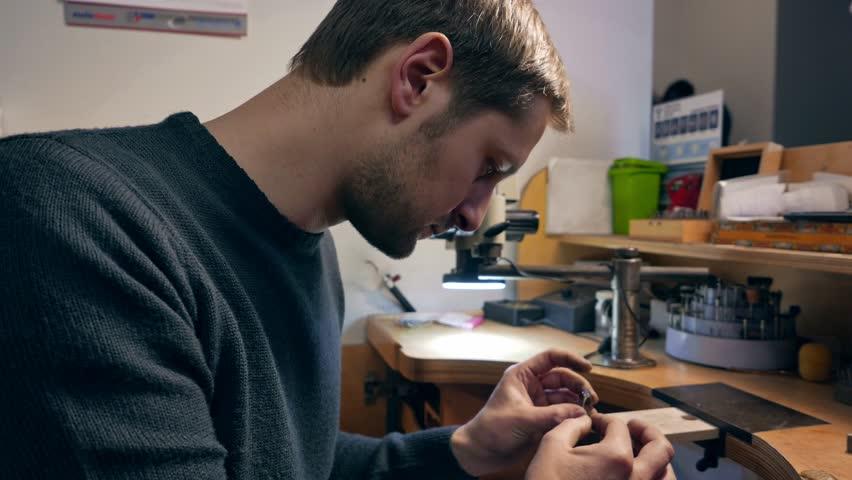 Jeweler at work in jewelery workshop | Shutterstock HD Video #22983817