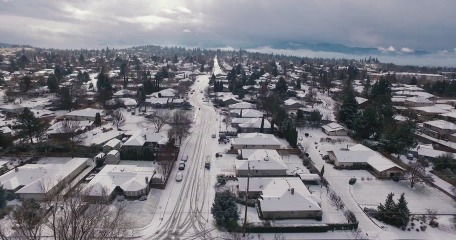 Aerial View Flying Over Snow-Covered Town