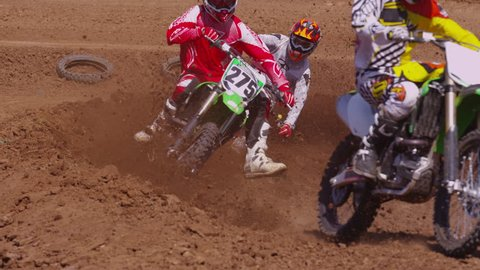 Motocross racers going around corner 4K (fully released)