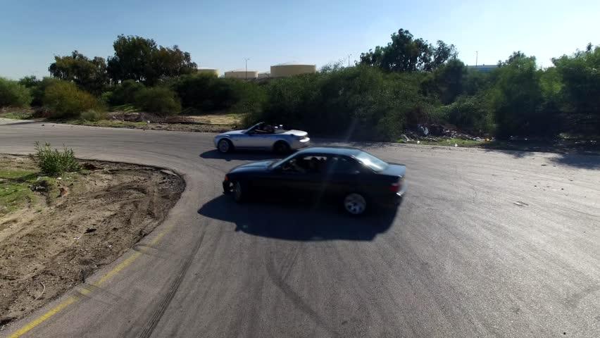 AERIAL:Sports cars make drifts