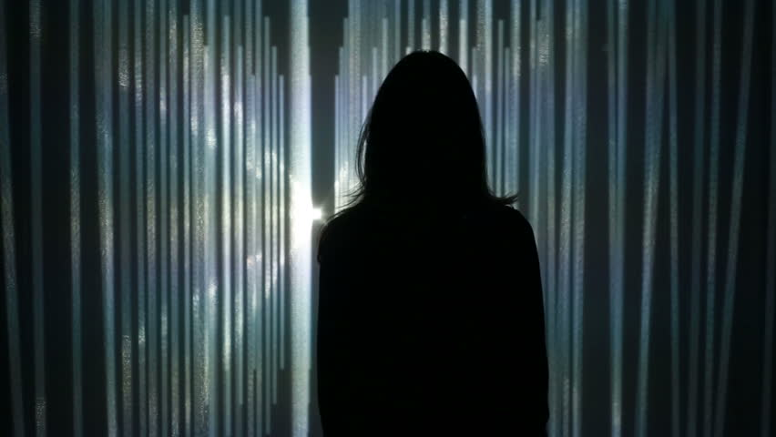 ABRAU-DURSO, RUSSIA - September 11, 2016: Girl looks at a visual installation. A new kind of art, generative graphics. Audio-visual exhibition in MARS Center, ABRAU-DURSO