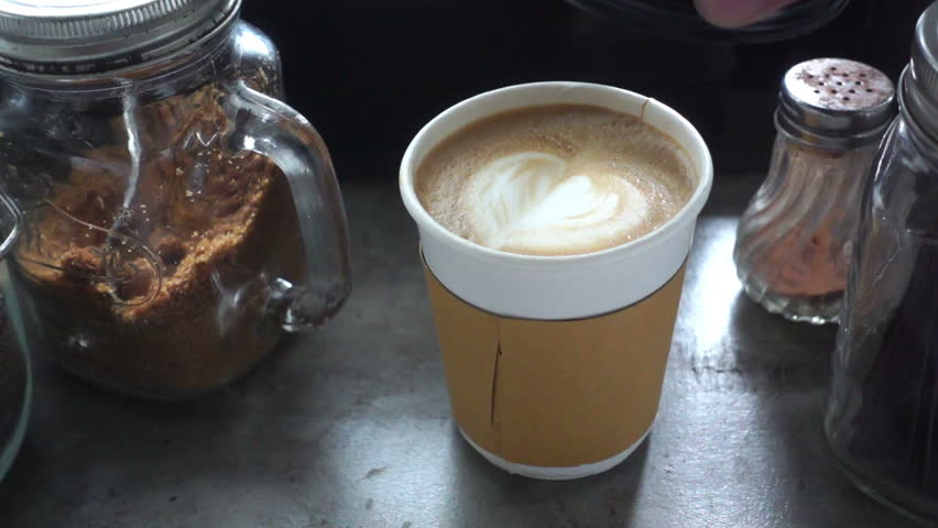 Closing a plastic cap on a take away paper cup of latte coffee, slow motion #23105947