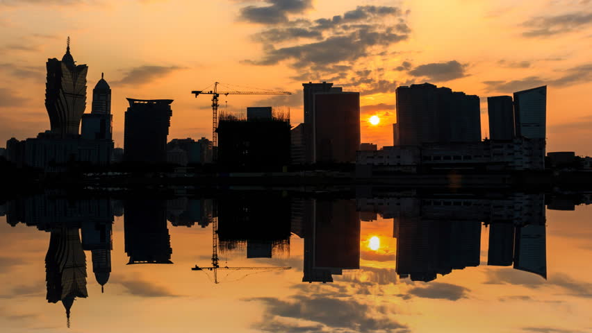 Silhouette Macau City Building On Sunrise And Reflection 4K Time Lapse (2 shots)