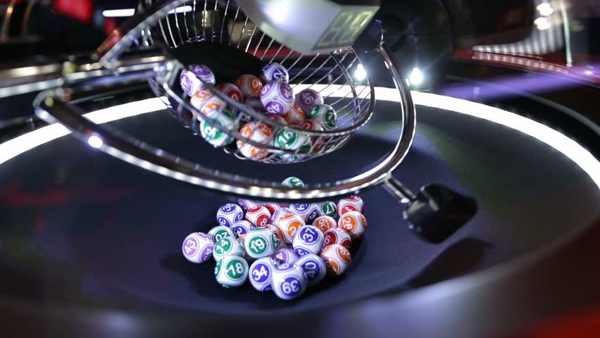 Colourful lottery balls in a lotto machine. Gambling machine and euqipment.
