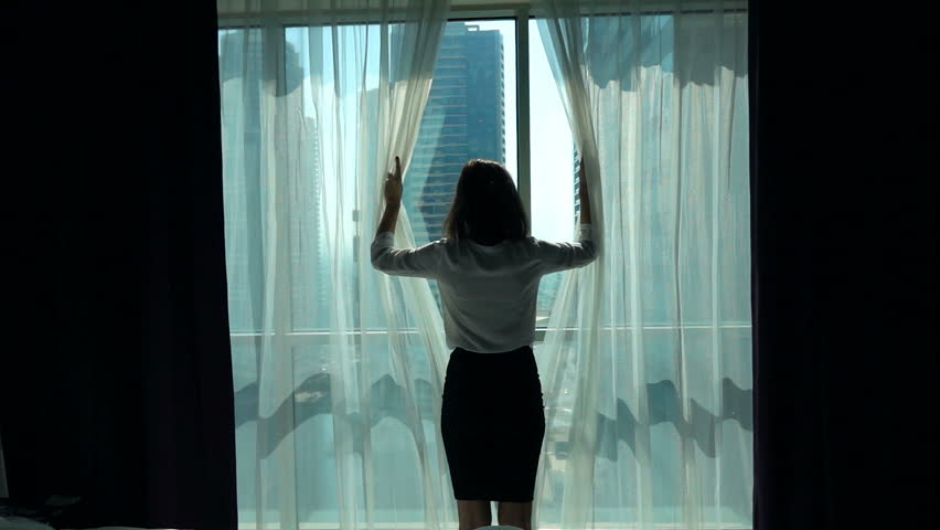 Businesswoman unveil curtains from window in office and admire view, super slow motion 240fps  | Shutterstock HD Video #23124142