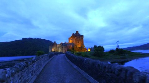 Beautiful dusk at illuminated Eilean Donan Castle over the lake in Scotland