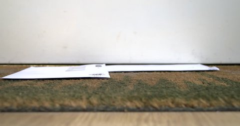 Household bills falling on a door mat