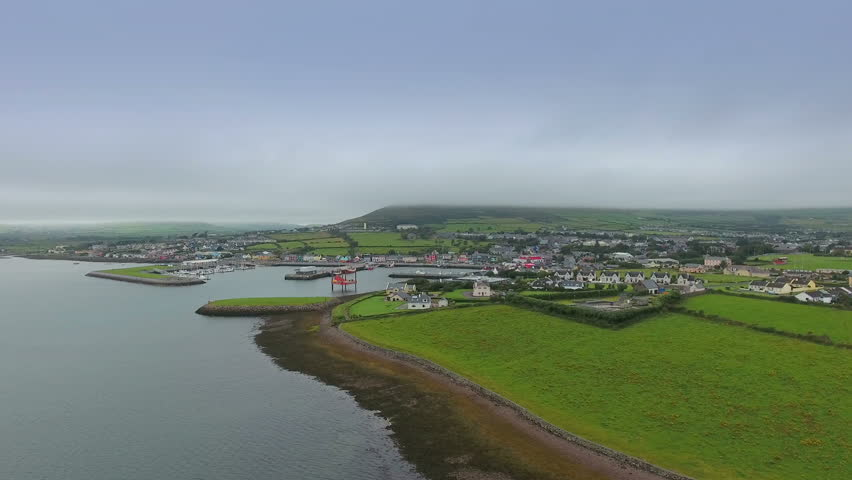Aerial shot of the small village of Dingle. County Kerrys Dingle Peninsula is one of Irelands most beautiful coastal regions. in Ireland