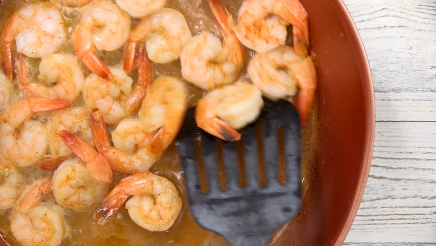 Slowly Stirring Shrimp in a Pan Sauteing #23172667