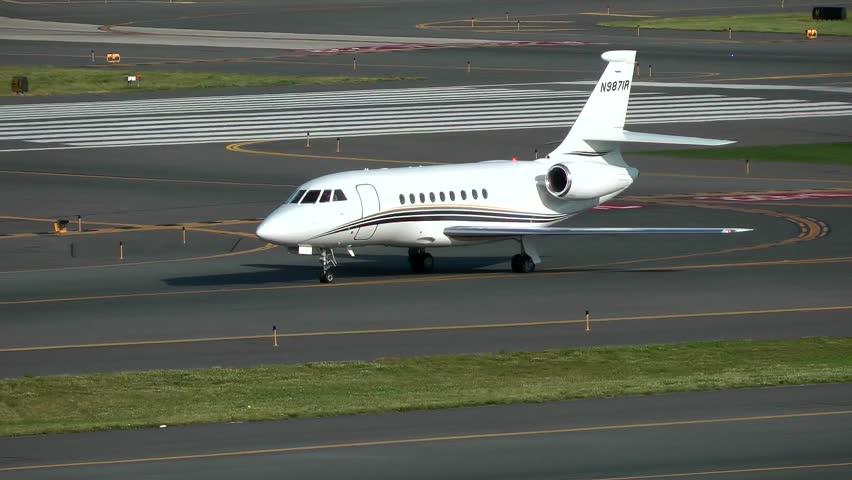 Dassault Falcon private jet plane arrival - Logan Airport Boston, Massachusetts USA - May 22, 2014