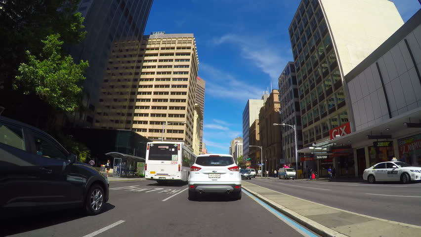 ADELAIDE, SOUTH AUSTRALIA - JUNE 12, 2016: Automobile POV driving through Adelaide city center and business district, along Grenfell Street to King William Street.
