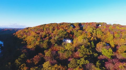 An aerial shot of a house tucked away in the mountains of Upstate New York. Shot in the autumn of 2016 in 4k.