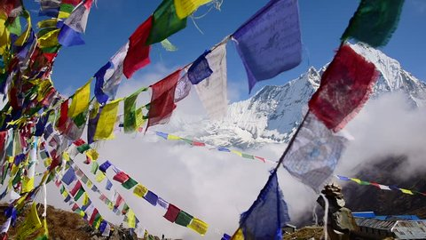 Machapuchare peak and prayer flags from Annapurna basecamp ,Nepal.