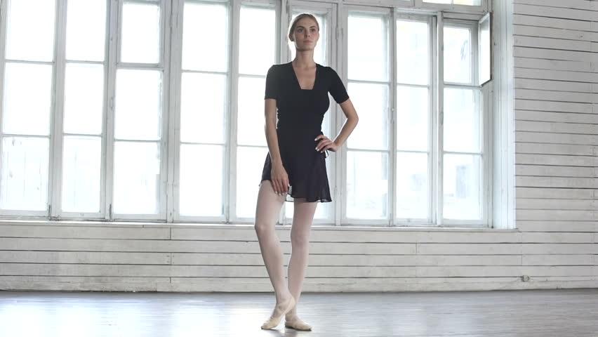 Ballet dancer raises a leg up in ballet class | Shutterstock HD Video #23228125