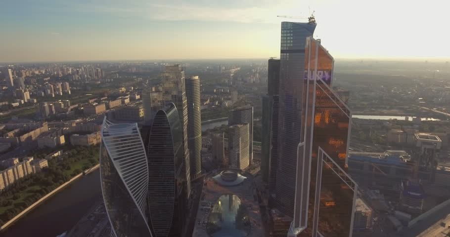 Business center Moscow City, aerial photography on the drone. Skyscrapers of glass and concrete in Moscow. Business center in the summer sun and surrounded by greenery. Kutuzovsky Prospect and Moscow | Shutterstock HD Video #23273377