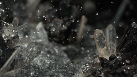 Water splash in crystal natural cave. Super slow motion close up