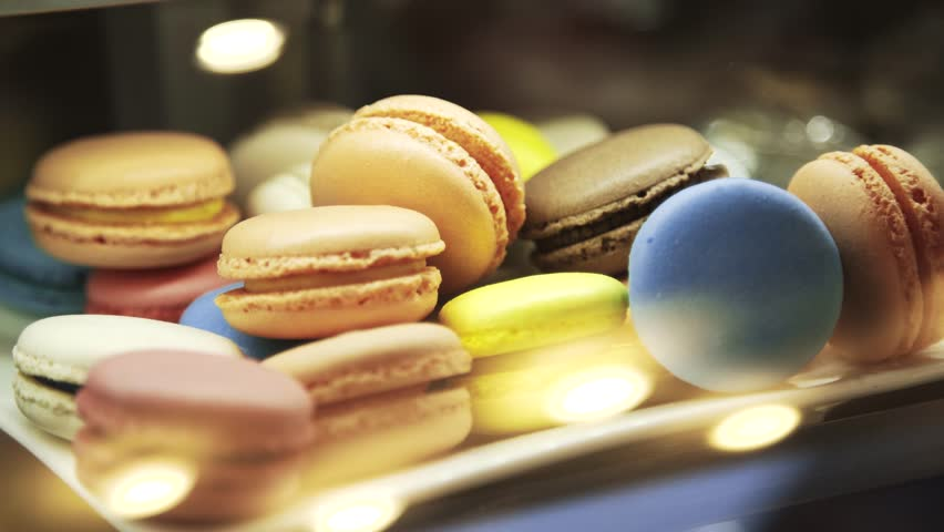 Colorful macaroons on showcase in a fancy cafe. Closeup real time locked down shot.