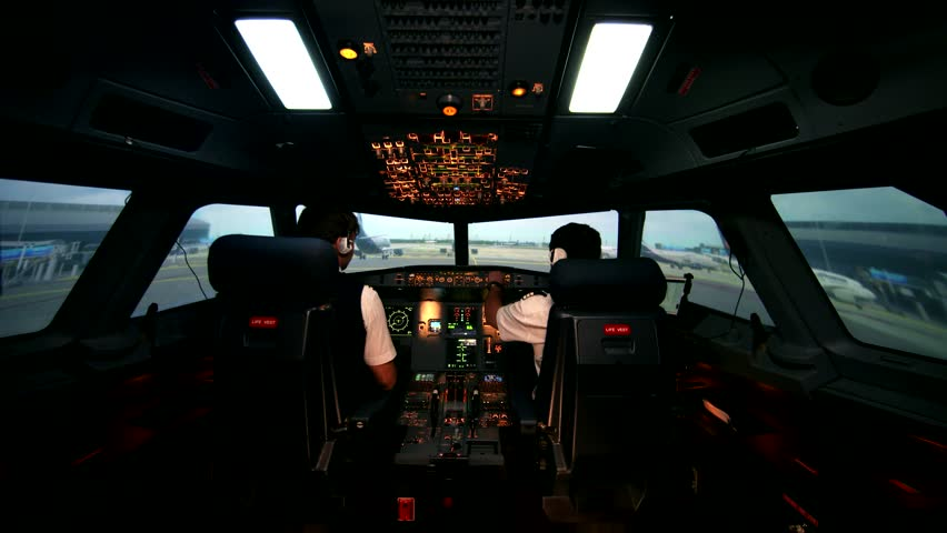 Preparing for departure and take off. Aero plane on runway of modern airport. Cabin crew perform pre-flight procedure, all lights and lamps are on | Shutterstock HD Video #23299417