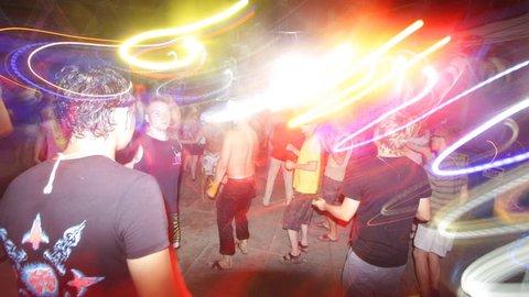 long exposure shooting technique to capture people dancing on dancefloor at music festival