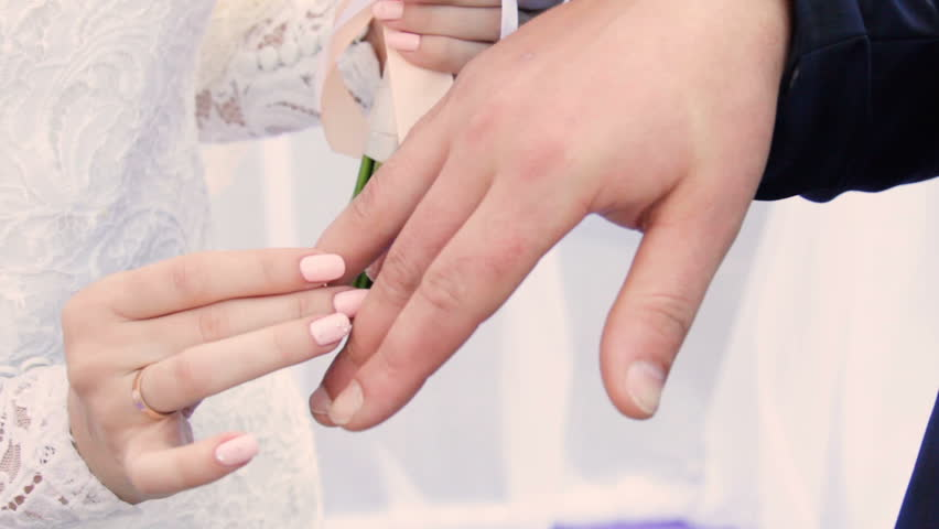 Bride Wears The Ring On The Finger Of The Groom Stock Footage